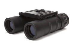Binoculars. Black binoculars isolated on a white background Royalty Free Stock Image
