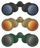 Binoculars. A selection of binoculars in black, tan and green colors Royalty Free Stock Image