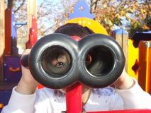 Binoculars. Curious kid whatching the exterior Royalty Free Stock Photos