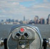 Binoculars. Long range binoculars and Manhattan skyline in the background stock photo