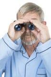 Binoculars. Man holding binoculars royalty free stock photography