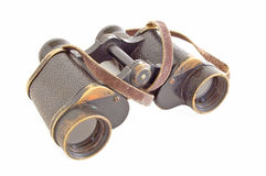 Binoculars. A pair of old vintage brass and leather binoculars isolated on white Stock Image
