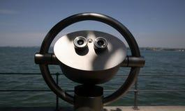Binoculars. Tourist binoculars overlooking lake constance Royalty Free Stock Images