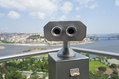 Binoculars on an aerial viewing platform over city Stock Photo