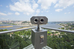 Binoculars on an aerial viewing platform over city Royalty Free Stock Image