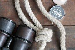 Binoculars And Compass Stock Photography