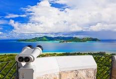 Binoculars And Island Praslin At Seychelles Royalty Free Stock Photos