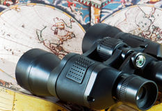 Binoculars on antique map Royalty Free Stock Image
