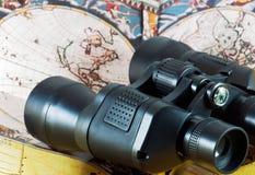 Binoculars on antique map Royalty Free Stock Image