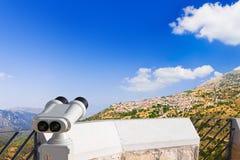 Binoculars and Arachova, Greece. Binoculars and Arachova on mountain Parnassos, Greece - travel background Royalty Free Stock Photo