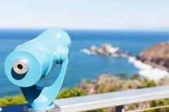 Binoculars at the beach. Binoculars overlooking gorgeous rocky seashore Stock Photography