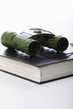 Binoculars on book Stock Image