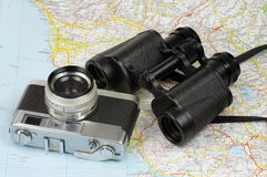 Binoculars, camera and map Royalty Free Stock Photo