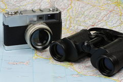 Binoculars, camera and map Stock Photography