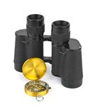 Binoculars and compass Royalty Free Stock Photos