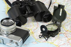 Binoculars, compass, camera and map Royalty Free Stock Photos