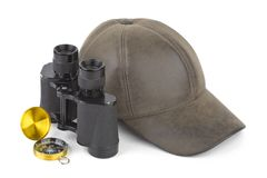 Binoculars, compass and cap Stock Photos