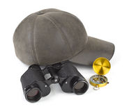 Binoculars, compass and cap Stock Photo