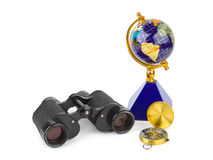 Binoculars, compass and globe Royalty Free Stock Photos