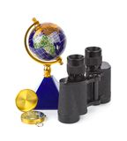 Binoculars, compass and globe Stock Photos