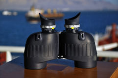 Binoculars on deck of boat Royalty Free Stock Photo