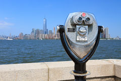 Binoculars in Ellis Island and Manhattan's skyline in the backgr Stock Photography