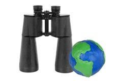 Binoculars and Globe Stock Image
