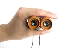 Binoculars in hand Stock Images