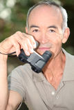 Binoculars in hand Stock Image