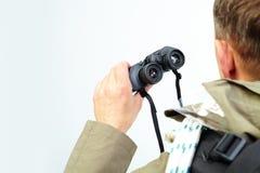 Binoculars in hand Stock Photography