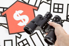 Binoculars and Home Sign Royalty Free Stock Photo