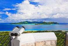 Binoculars and island Praslin at Seychelles Royalty Free Stock Photos