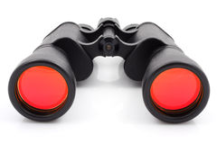 Binoculars isolated. A black binoculars with ruby surface over lenses royalty free stock photography