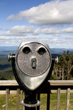Binoculars in landscape Royalty Free Stock Image