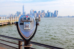 Binoculars on Liberty Island, NYC. Antique binoculars on Liberty Island with view to Manhattan, New York City Royalty Free Stock Photo