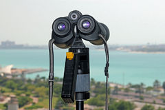 Binoculars looking at a coastal view Royalty Free Stock Images