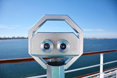 Binoculars looking at the horizon Royalty Free Stock Photos