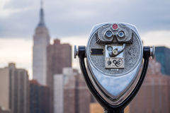 Binoculars looking at New York City. Binoculars looking at out of focus midtown Manhattan in New York City Stock Photography