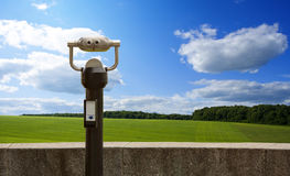 Binoculars looks to idyllic landscape Royalty Free Stock Photo