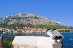 Binoculars and Makarska at Croatia Stock Image