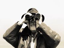 Binoculars - man explorer stock photo