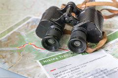 Binoculars and map - route planning Royalty Free Stock Photography