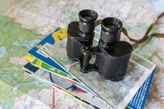 Binoculars and map - route planning Stock Image