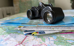 Binoculars and map - route planning Stock Photos
