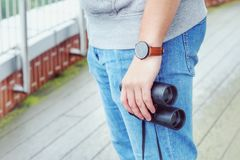 Binoculars. Midsection of a hipster with binoculars Royalty Free Stock Images