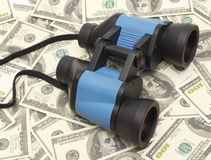 Binoculars and money Royalty Free Stock Photography
