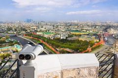 Binoculars and Moscow Kremlin Stock Photography