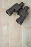 Binoculars on a natural blue wood surface. Top view with copy sp Royalty Free Stock Images