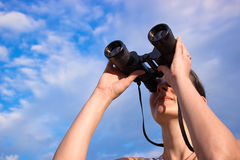 With binoculars in nature Stock Images