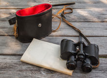 Binoculars notebook with a blank page Royalty Free Stock Images